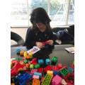 Bella have fun with building block patterns.