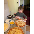 Bogdan making pizza.
