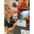 Jazmin painting pebbles.