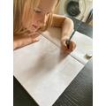 Jazmin doing her maths very neatly.