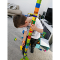 Zachary is building a very tall tower!