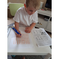 Harry designing a phonics word search for Nanny!