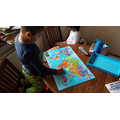 Krissh doing a world map jigsaw.