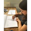Elsie working on her Oceans page.