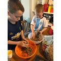 Zac and Hayden making bird feeders.