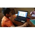 Krissh doing maths online.