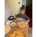 Bogdan making pizza.