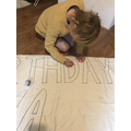 Forest made a banner for his Grandma's birthday.