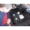 Andrew Experimenting With Ice and Insulators
