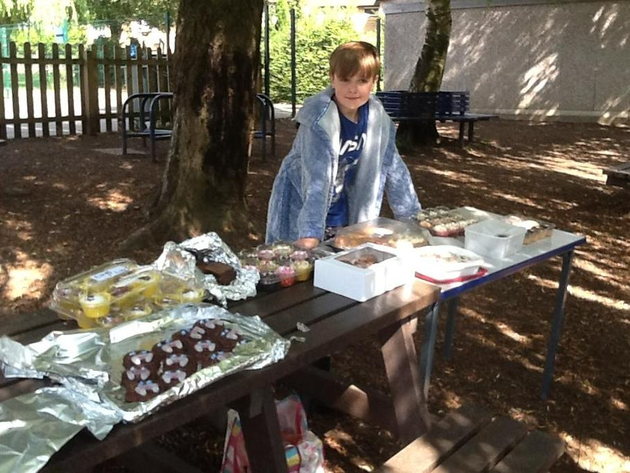 Cake stall and seller ready for action!