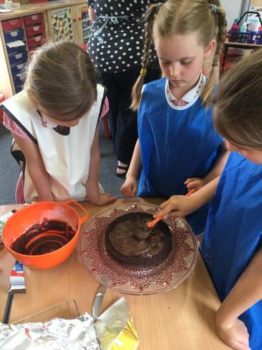 Icing the chocolate cake.