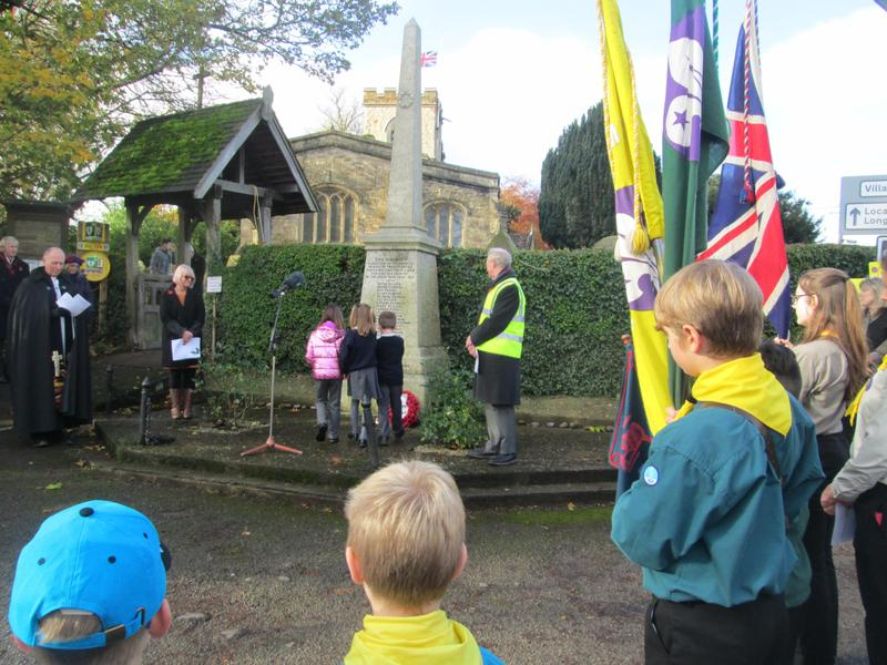 Year 2 Children join with Scouts to lay our School wreath at the memorial in the village