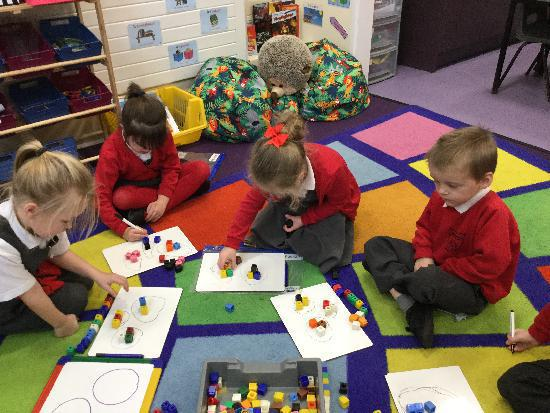 The children found out that 3 lots of 3 equals 9.