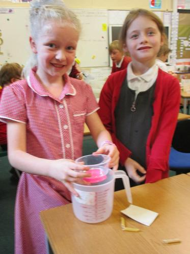 The girls used a balloon to fix their bucket.