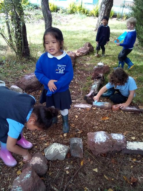 Decorating the path to our fairy tree.