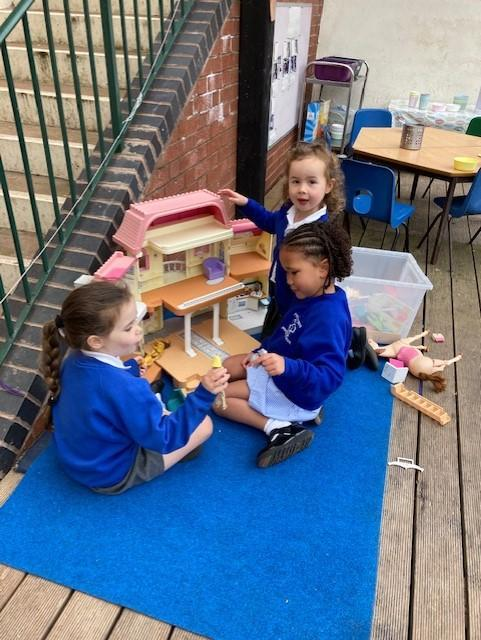 playing co-cooperatively, sharing and taking turns.