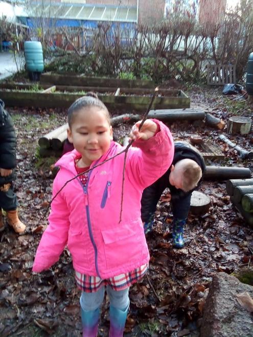 Finding a stick to make a stick man.