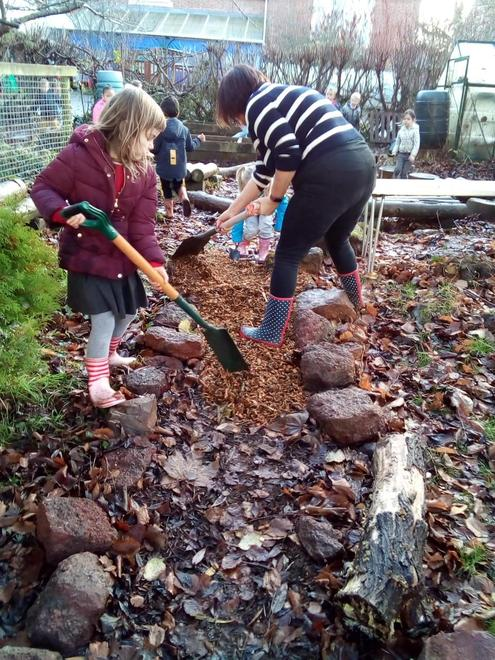 spreading wood chip to make a path.