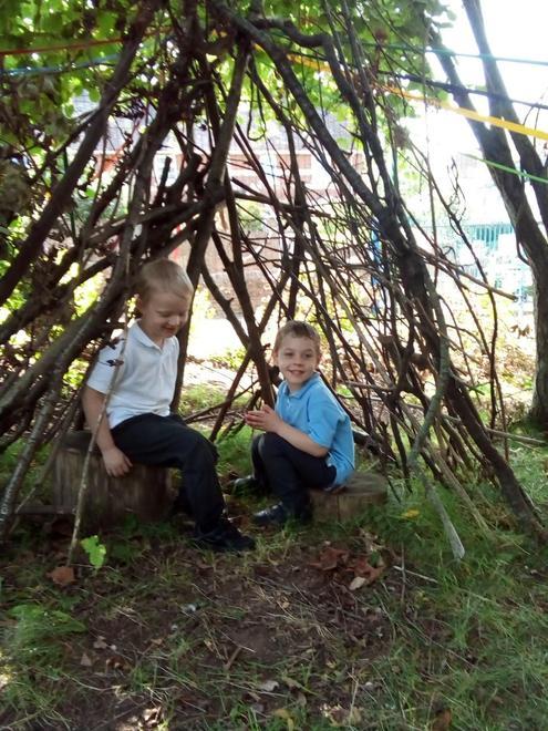 Finding a comfortable spot in the garden den.