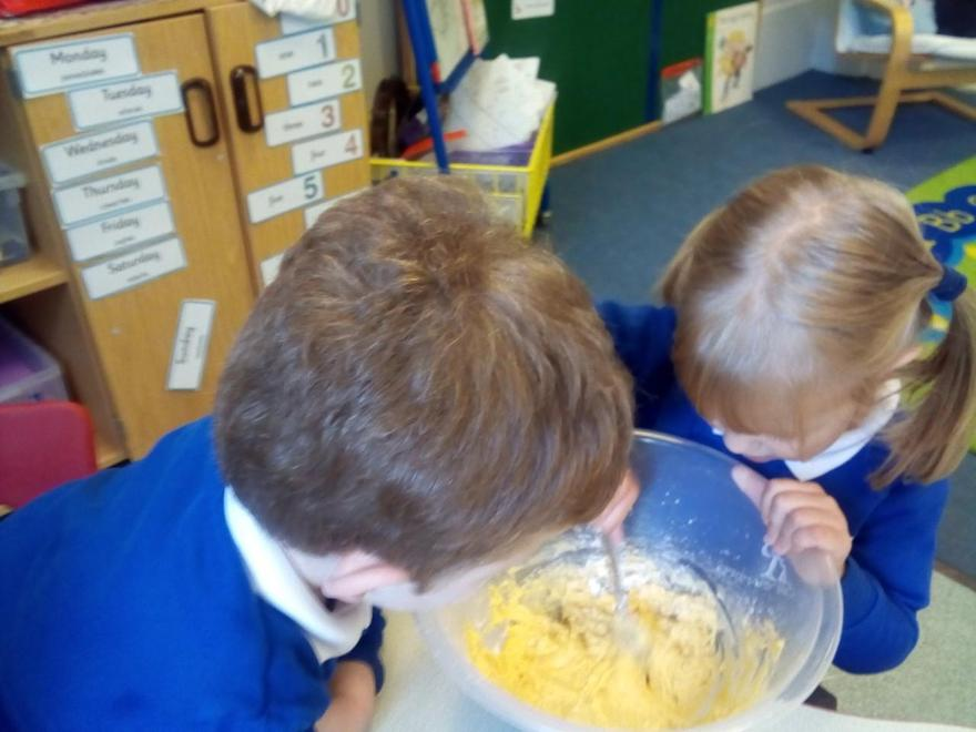 watching the changes as they mix the ingredients.