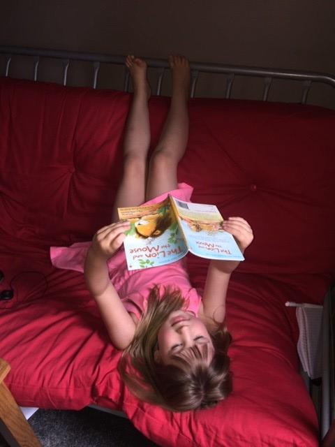 Summer has found a relaxing way to read a book!