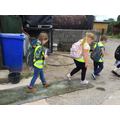 Walking over a disinfectant carpet to protect the farm from germs on our shoes.
