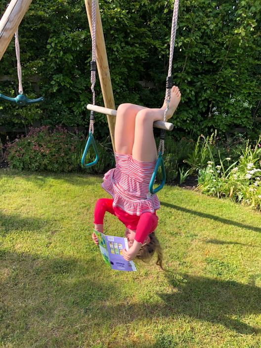 Tilly swings like an acrobat and can still read!