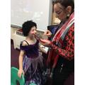 Mrs Wardle applying Widow Twanky's make-up