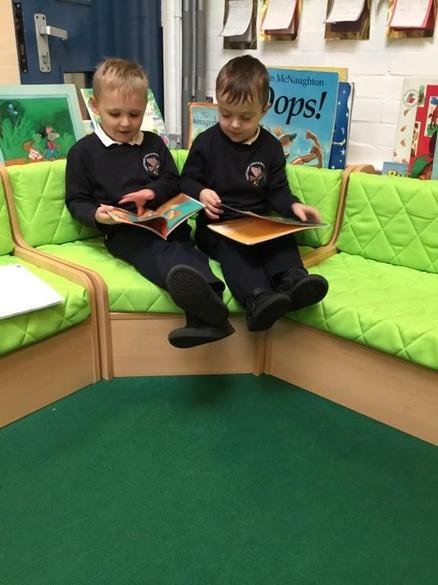 Reading together in our school library