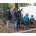 Princes Trust and Children writing in the Woodland Walk.jpg