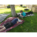 Children reading in new outdoor peaceful patch.JPG