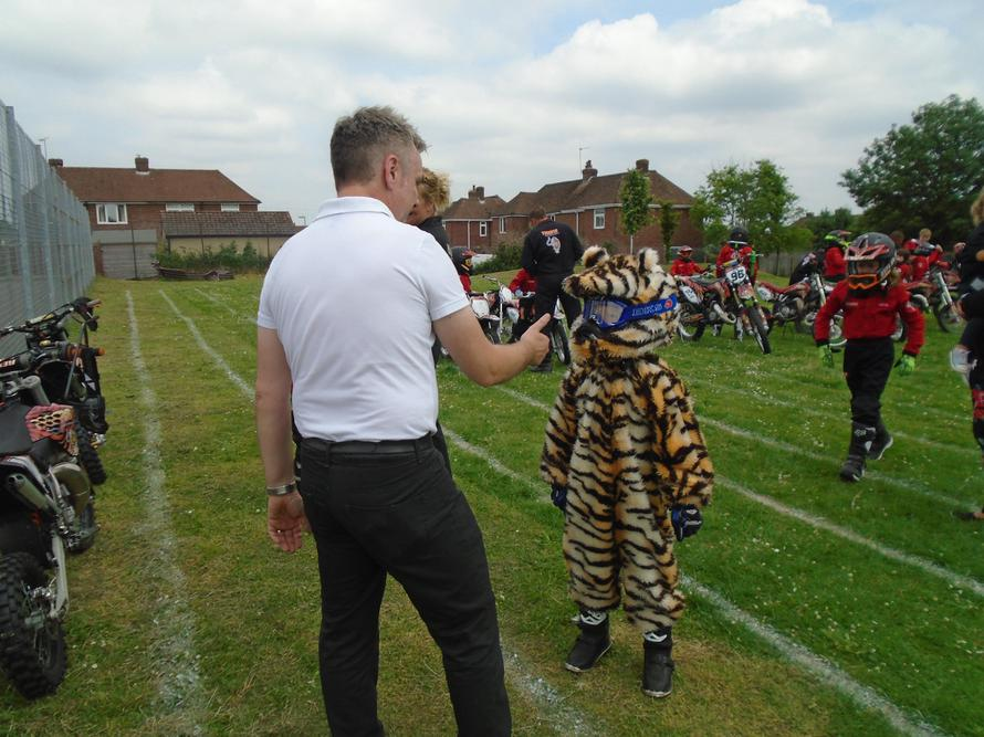 Mr James meeting Tiger's mascot, Jake!
