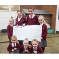 Children who raised money bag-packing