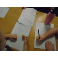 Writing on lined paper with our grey pencils
