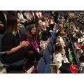 The choir take their seats