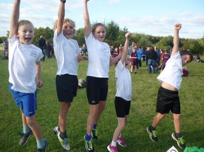 Our very excited cross country team ready to go!!
