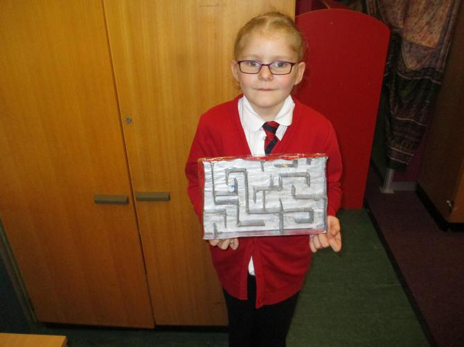 Piper made a Labyrinth game. Wonderful!