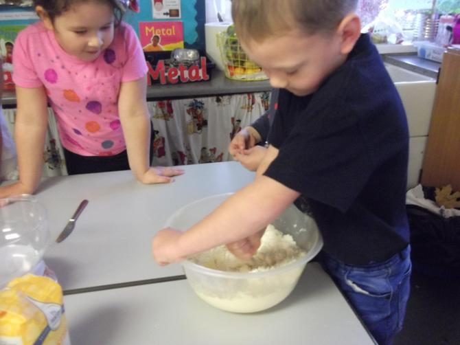 Stirring to cover butter in flour & sugar