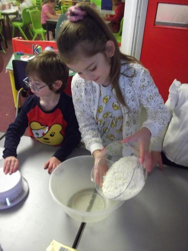 Adding flour to bowl