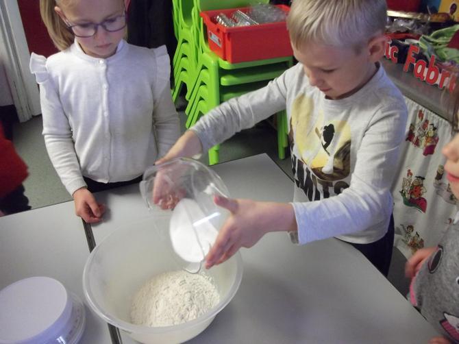 Adding sugar to bowl
