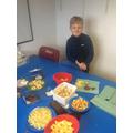 Logan enjoying the Christening party buffet!