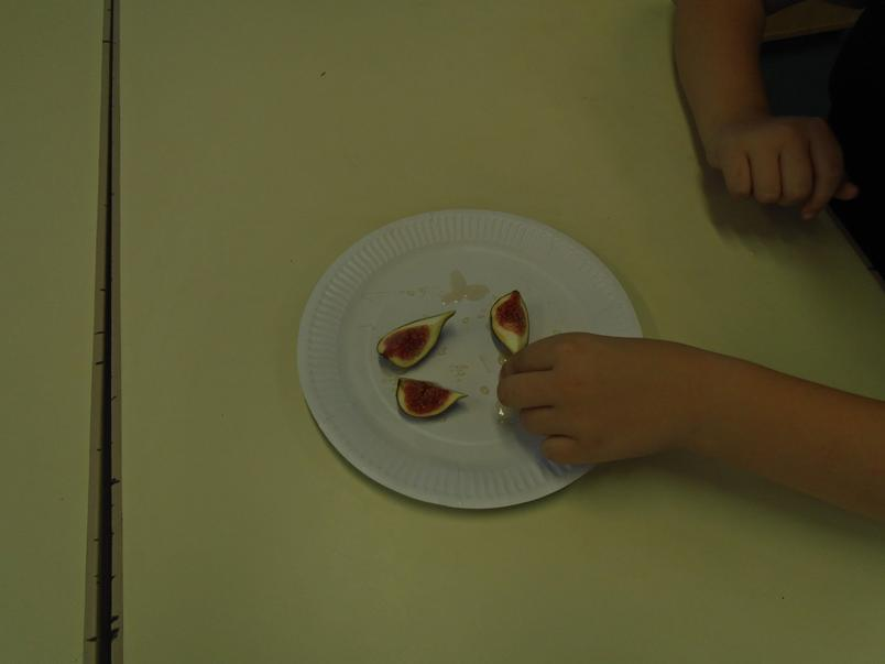 Trying typical Roman food of figs and honey
