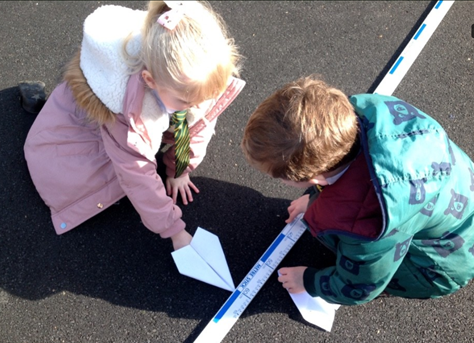 Year 1 and 2 measuring the length their planes flew.