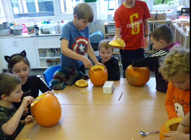 Annual pumpkin carving where the older children help the younger ones