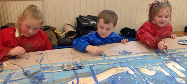 KS1 pupils painting their Nativity backdrop with Artist Darrell Wakelam