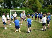 Crocket coaching on the field
