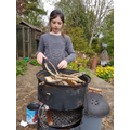 Isla making charcoal