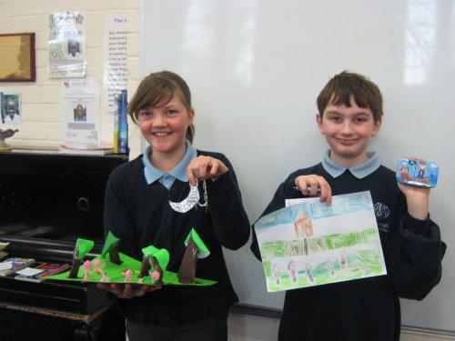 Children showing their winning entries