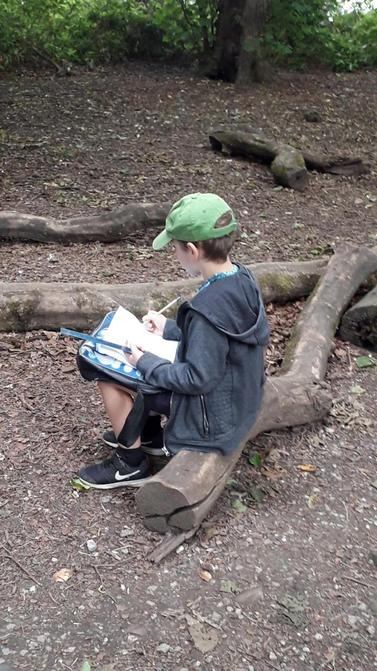 William drawing squirrels in Towneley Park