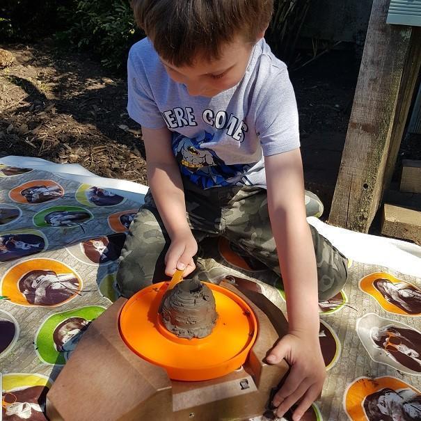 Edward making clay pots